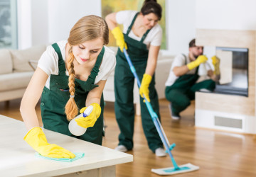 Group of friends as a professional cleaners tiding up big apartment